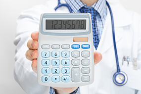 Doctor holding calculator