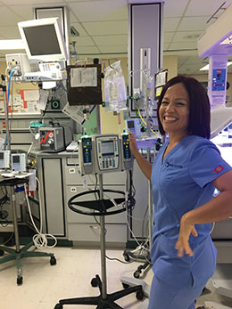 Nurse Using Alaris System