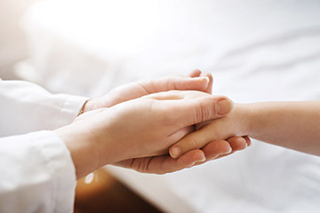 Holding hands of patient