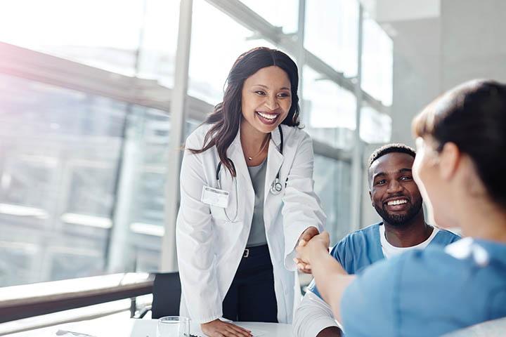 doctor nurse shaking hands